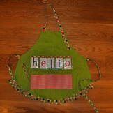 Show and Tell Apron (green apron with pink pocket)