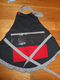 Show and Tell Apron (black with red pocket and houndstooth trim)